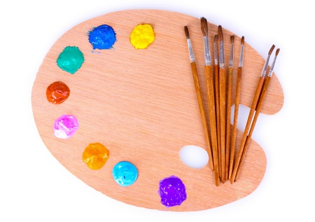 wooden art palette with blobs of paint and a brush on white background Stock Photo - 10164671