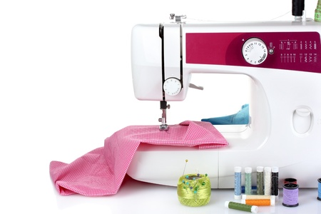 sew: sewing machine and fabric isolated on white Stock Photo