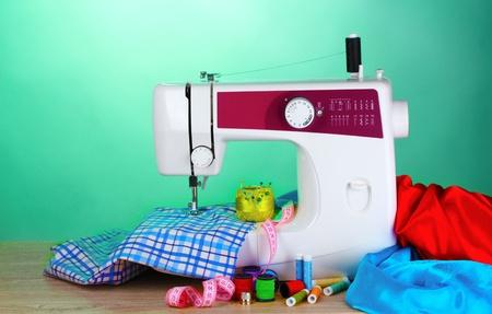 display machine: sewing machine and fabric on green background