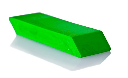 green eraser isolated on a white photo