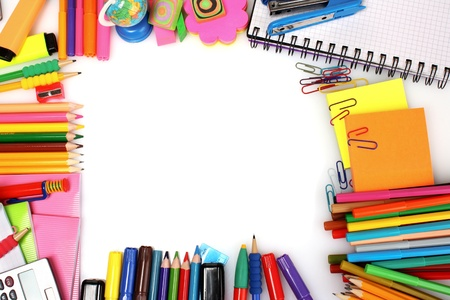 stationery: pencils, markers and paper isolated on white
