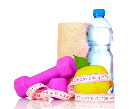 towel, apple with measure tape, dumbbells and water bottle isolated on white Фото со стока