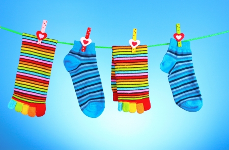 bright socks on a blue background Stock Photo - 10249746