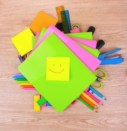 bright stationery on wooden background