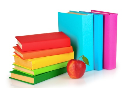 Books and apple isolated on white Stock Photo - 10249235