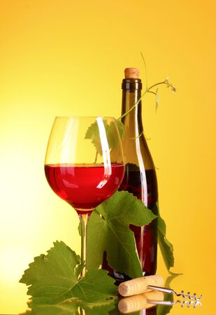 Red wine on yellow background Stock Photo - 10249395