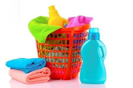 Detergents and towels in basket isolated on white Stock Photo