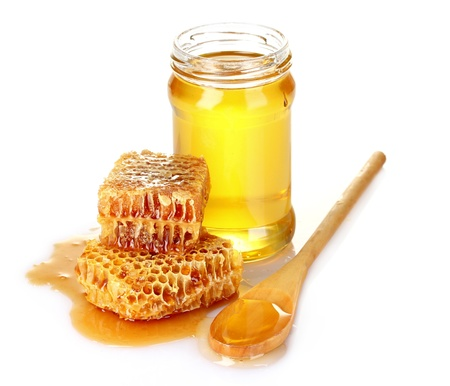 honey cell: Beautiful combs, spoon and honey in jar isolated on white