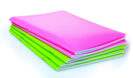 green and pink notebook isolated on white photo