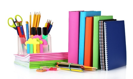 school supplies: bright stationery and books isolated on white