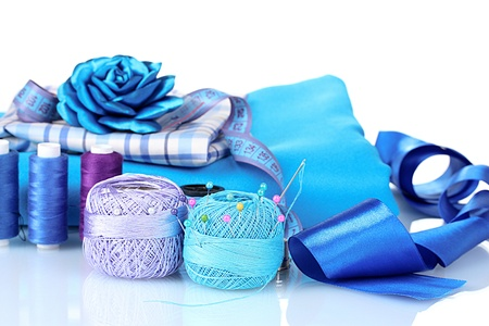 bright blue yarn, fabric, satin ribbon and measuring tape isolated on white Stock Photo - 10293519