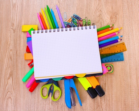 bright stationery on wooden background photo