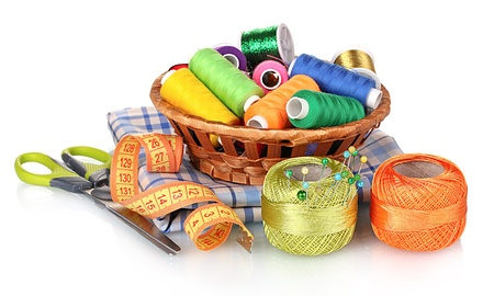needlecraft: bright threads in basket, scissors and measuring tape isolated on white Stock Photo