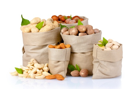 variety of nuts in bags on white isolated Stock Photo - 10293544