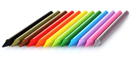 bright crayons to draw isolated on white photo