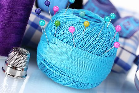 bright blue yarn, fabric and measuring tape photo