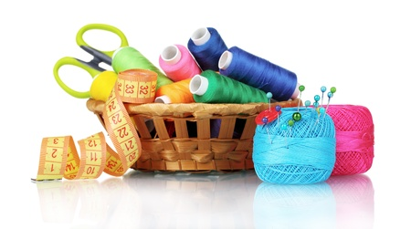 bright threads in basket, scissors and measuring tape isolated on white Archivio Fotografico