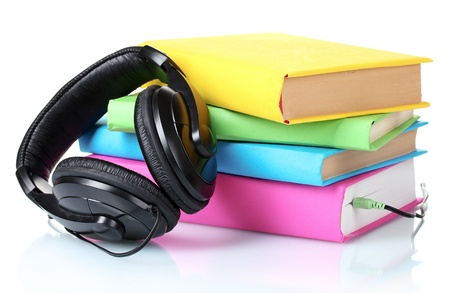 Headphones on books isolated on white photo