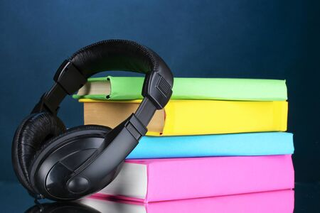 Headphones on books on blue background Stock Photo - 10310183