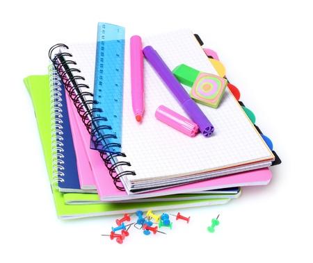 notebook, graffette, righello e marcatori isolate on white