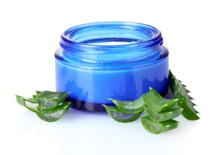 moisturize: chopped leaf aloe veraand cream isolated on white