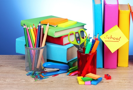 stationery: bright stationery and books on blue background Stock Photo