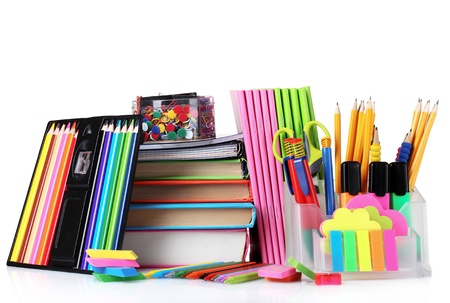 bright stationery and books isolated on white photo
