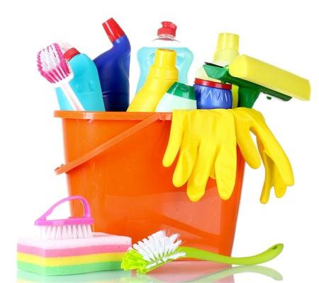 detergent bottles, brushes, gloves and sponge in bucket isolated on white photo