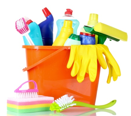 bright housekeeping: detergent bottles, brushes, gloves and sponge in bucket isolated on white Stock Photo