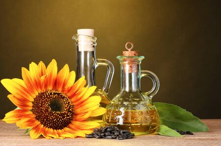 sunflower oil and sunflower on yellow background Stock Photo