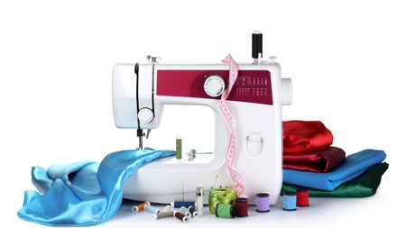 sewing machine and fabric isolated on white photo