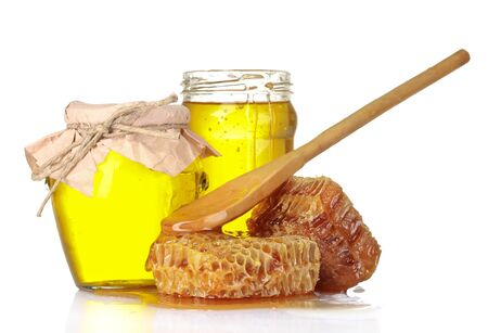 Beautiful combs, spoon and honey in jar isolated on white photo