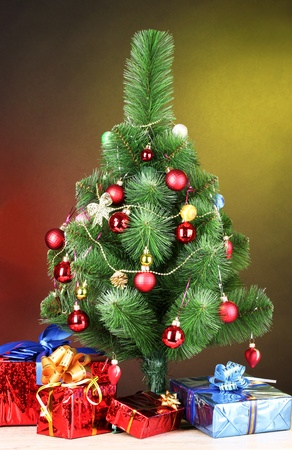beautiful Christmas tree and gifts on wooden table Stock Photo - 10359434