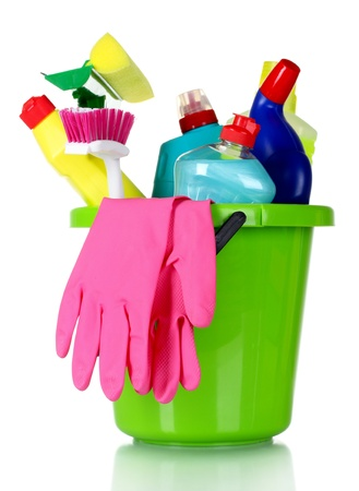 bright housekeeping: detergent bottles, brushes and gloves in bucket isolated on white