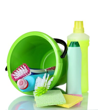 bright housekeeping: detergent bottles, brushes and sponges in bucket isolated on white