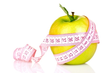 apple and measuring tape isolated on white photo