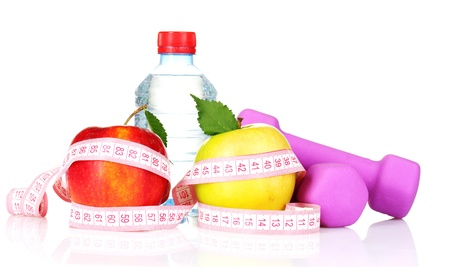 towel, apple with measure tape, dumbbells and water bottle isolated on white photo