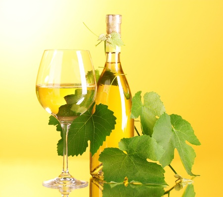 white wine: White wine on yellow background Stock Photo