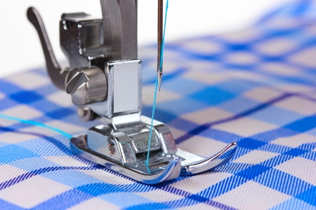 sewing machines: sewing machine and blue fabric