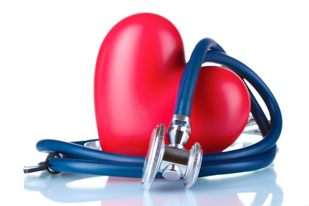 heart medical: Medical stethoscope and heart isolated on white
