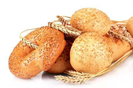 bread and buns with sesame seeds and spikelets isolated on white photo
