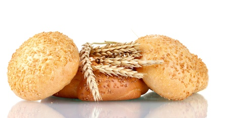 bagel and buns with sesame seeds and spikelets isolated on white photo