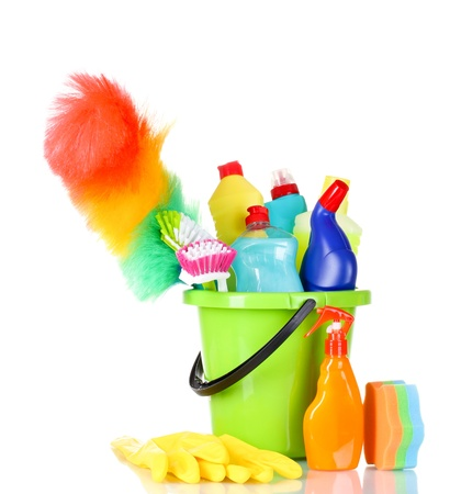 bright housekeeping: detergent bottles, brushes, gloves and sponges in bucket isolated on white