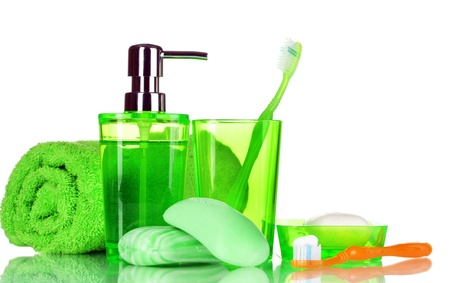 green bathroom accessories, soap and towel isolated on white