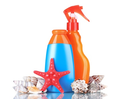 sunblock: sunblock in bottles, shells and starfish isolated on white