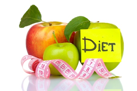 Concept of a diet. Many fresh ripe apples with measuring tape isolated on white