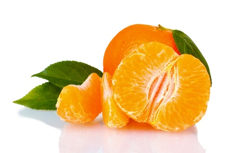 Fresh tangerine with leaves and segments isolated on white