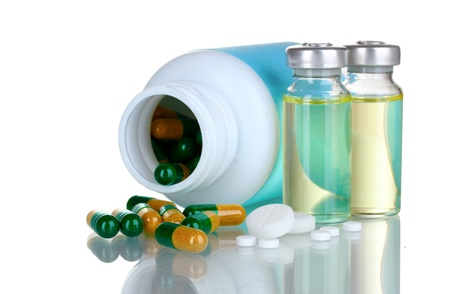 Medical bottles, ampoule and pills isolated on white Stock Photo - 10470848