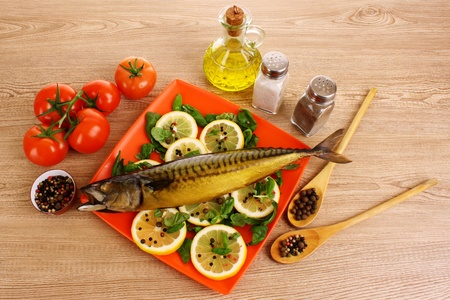Mackerel with lemon, tomato, oil and pepper photo