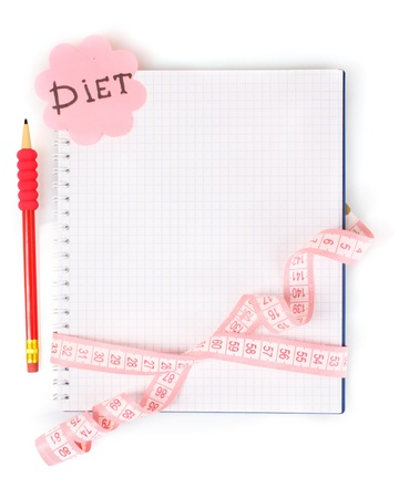 weightloss plan: Planning of a diet. Notebook measuring tape and pencil isolated on white Stock Photo